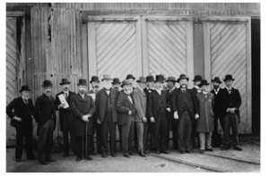 Councillor Evans, fourth from left in 1900 – outside the Adelaide Rd tram barns on municipalisation  of  tramways.  Wellington City Archives 00138:0:8703