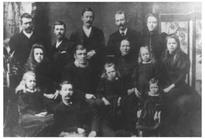 George and Emma Baker (centre) with their 12 children. William George is 2nd from left in the front. [Photograph courtesy John McNeil, ChCh]